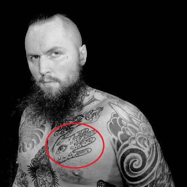 Aleister Black-angelic palm reader tattoo