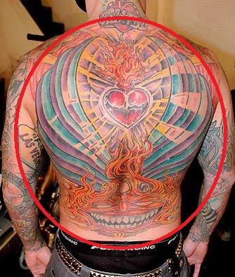Carey Hart heart wings flaming face tattoo