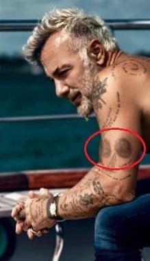 Gianluca Vacchi circles tattoo