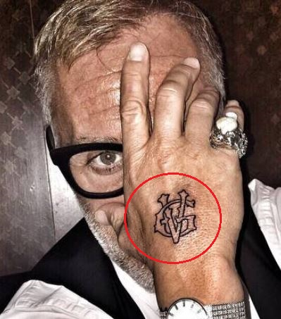 Gianluca Vacchi logo tattoo