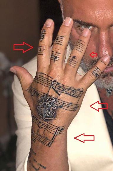 Gianluca Vacchi music notes tattoo