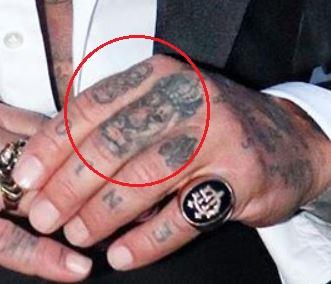 Gianluca Vacchi rings lion tattoo