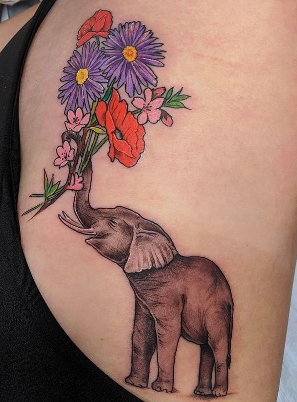 elephant with bunch of flowers-tattoo