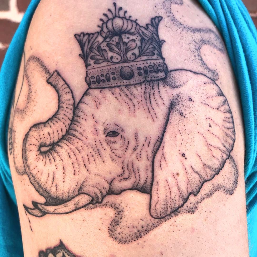 elephant with crown tattoo