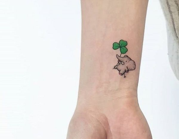 elephant with shamrock leaf-tattoo