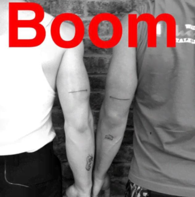 nick jonas-arrow tattoo