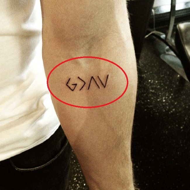 nick jonas-god is greater than highs and lows tattoo