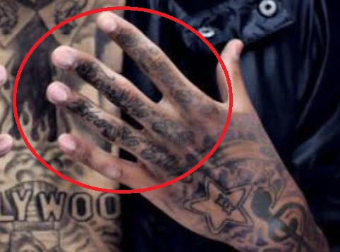 Kid Ink Left Hand Fingers Tattoo