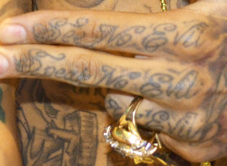 Kid Ink Left Hand Tattoos