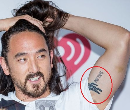 Steve Aoki Left Bicep clone Tattoo