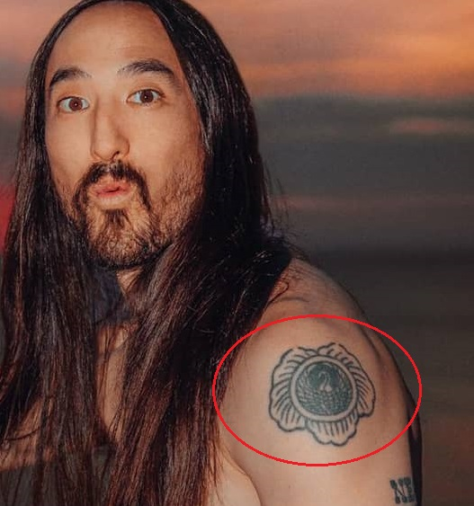 Steve Aoki Left Shoulder Tattoo