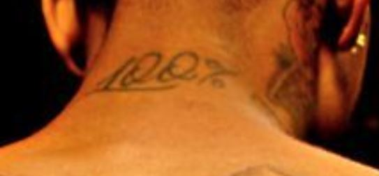 Tyga Back Neck Tattoo