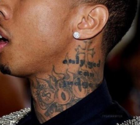 Tyga Cross, Flames Tattoo