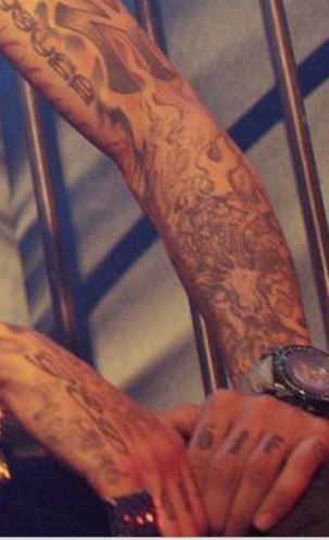 Tyga Left Arm Tattoos