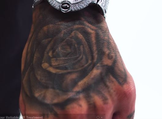 Tyga Left Hand Rose Tattoo