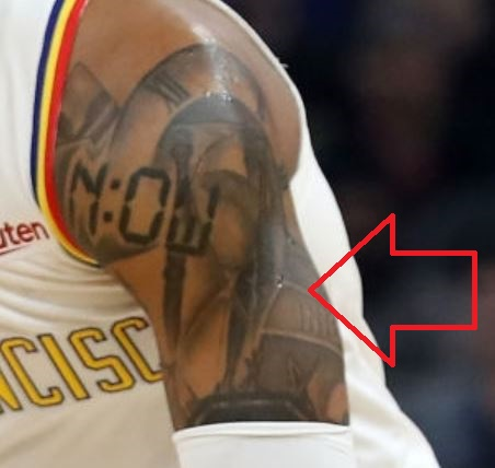 D Angelo Left Bicep Tattoo