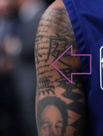 D Angelo Writing on Right Bicep Tattoo