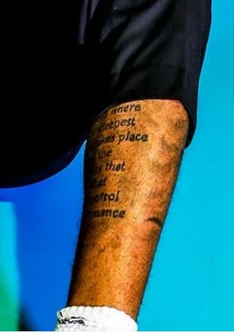 D Angelo writing on leg