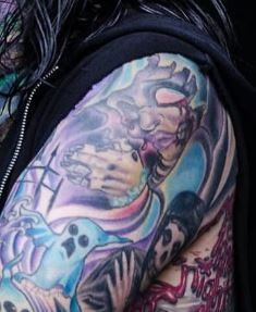 Chris Left Bicep Tattoo