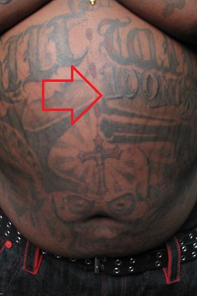 Rick Ross Cross on Stomach Tattoo