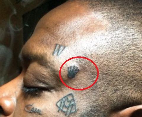 Rick Ross Crown Tattoo
