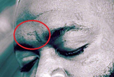 Rick Ross Forehead Tattoo