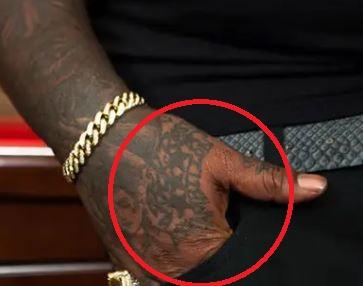 Rick Ross Hand Name Tattoo