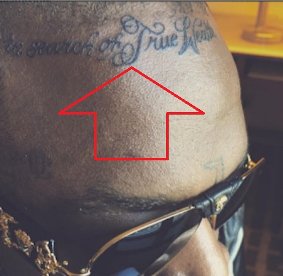 Rick Ross In search of some wealth Tattoo