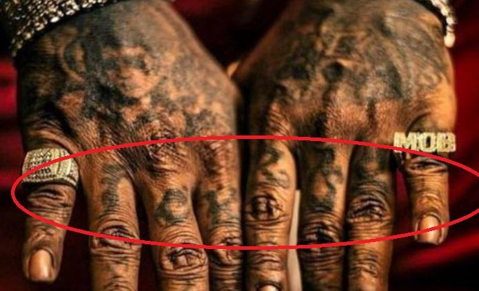 Rick Ross Name on Finger Tattoo