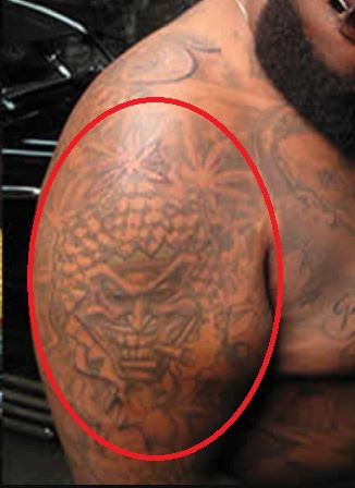 Rick Ross Right Bicep Face Mask Tattoo