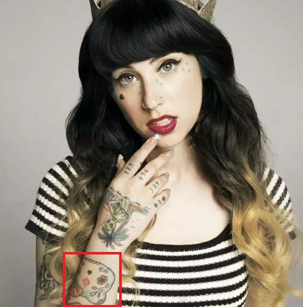 Kreayshawn-Hello Kitty Sugar Skull Tattoo