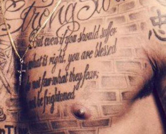Marcus Chest Tattoo