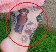 Tess Holliday kitty spiderweb kid tattoo