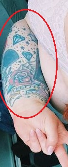 Tess Holliday spiderweb rose tattoo