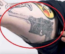 Action Bronson gun tattoo