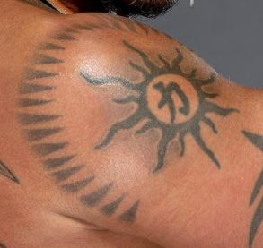 Rey modified tribal sun tattoo