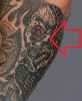 Rey skull on right inner arm tattoo