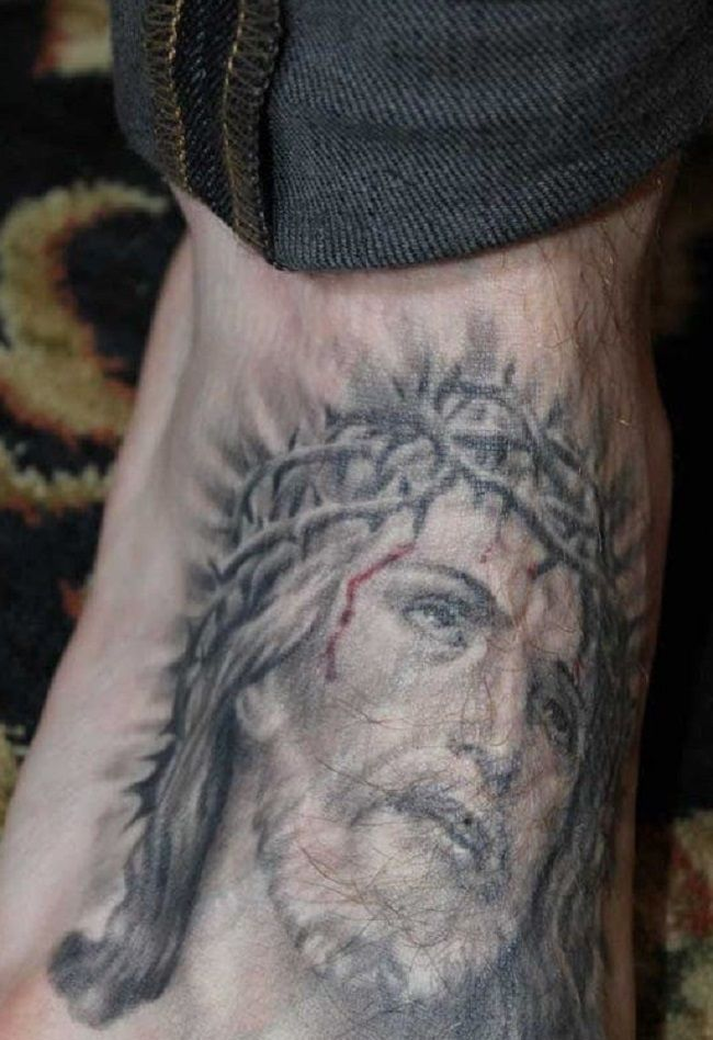 Trace Cyrus-Jesus with Crown of Thorns Tattoo