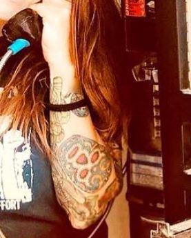 Lita skull tattoo