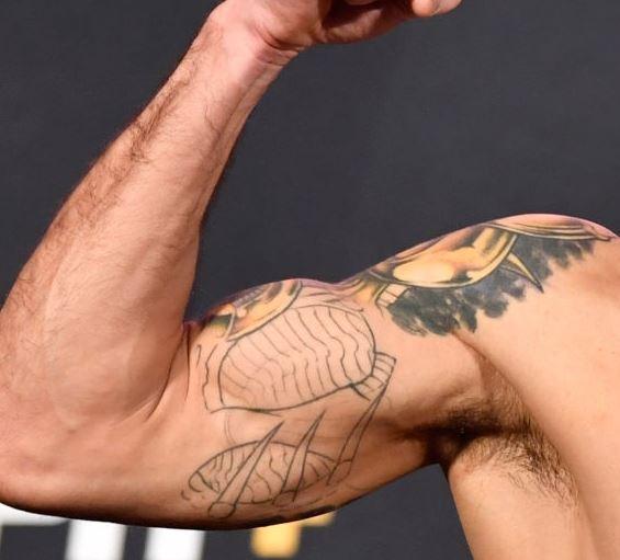 Raphael right bicep Tattoo