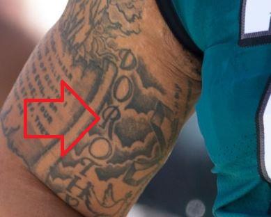 Brandon right bicep writing Tattoo