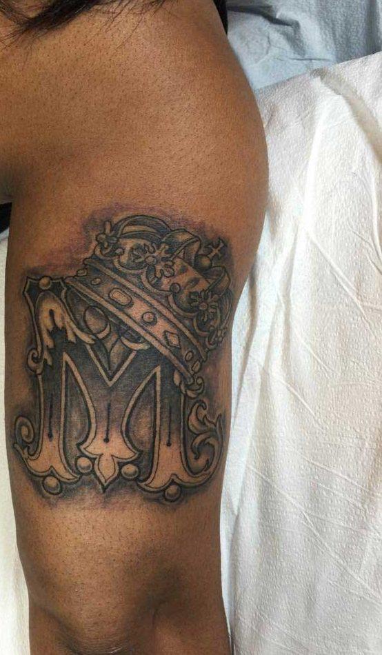 Letter M Tattoo Design