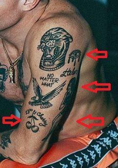 Macklemore_woman_eye_cherry_tattoo-