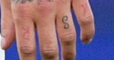 Marcelo letters on left Hand Tattoo