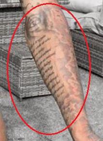 Marcus Rashford eye writing tattoo