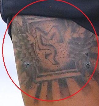 Marcus Rashford logo tattoo