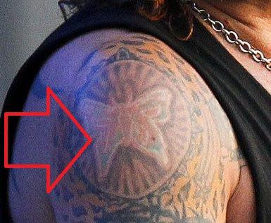 Vince bicep Tattoo