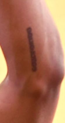Amine writing on left arm Tattoo