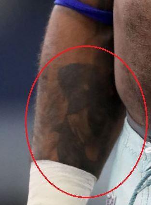 Ezekiel Elliott dog tattoo