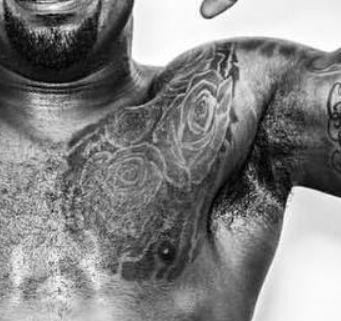 Ezekiel Elliott roses tattoo